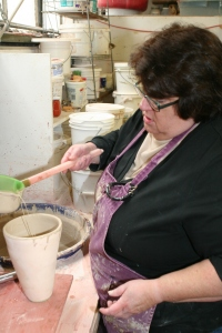"After first ""bisque"" firing. Step 1: Pouring glaze into the vase."